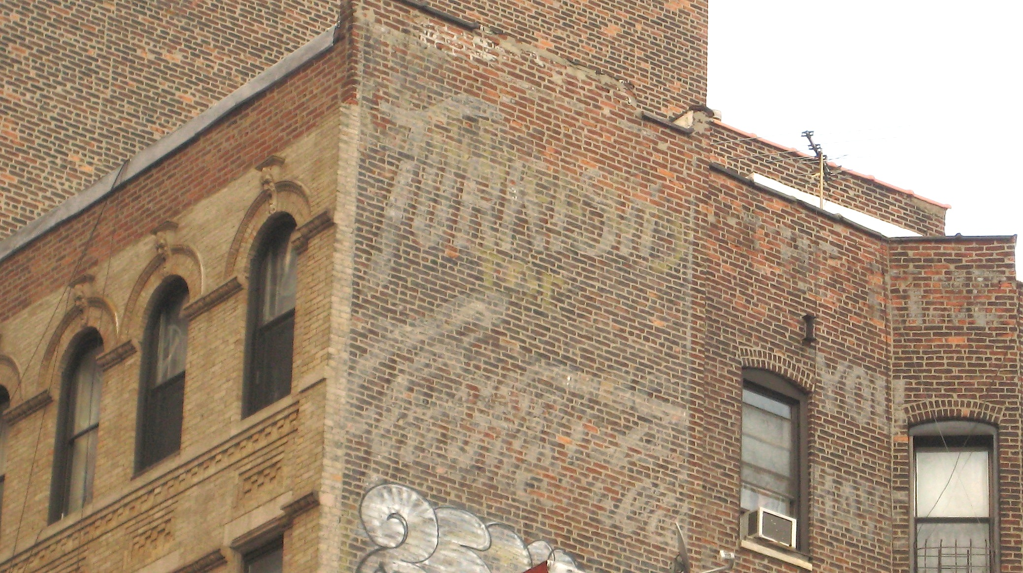 Vintage Ads Fading Away On Brick Buildings