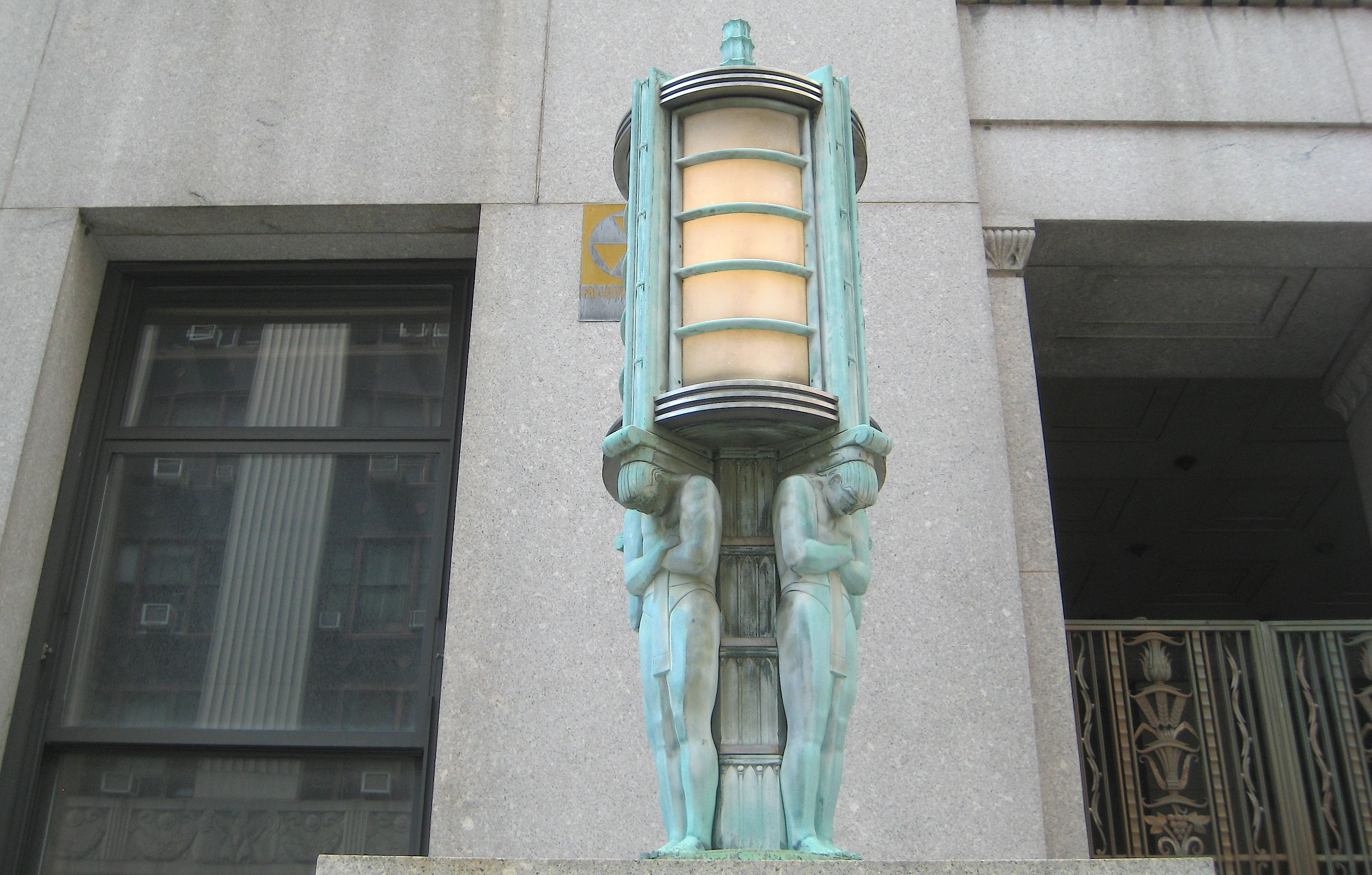 art deco lanterns on a centre street building ephemeral new york. Black Bedroom Furniture Sets. Home Design Ideas