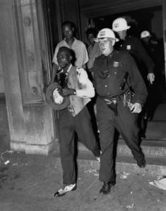 Police Officer Leading Injured Man