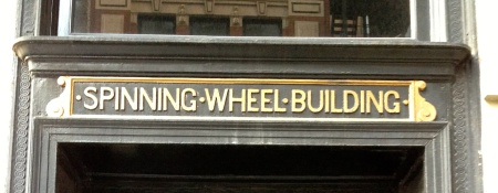 Spinningwheelbuildingsign