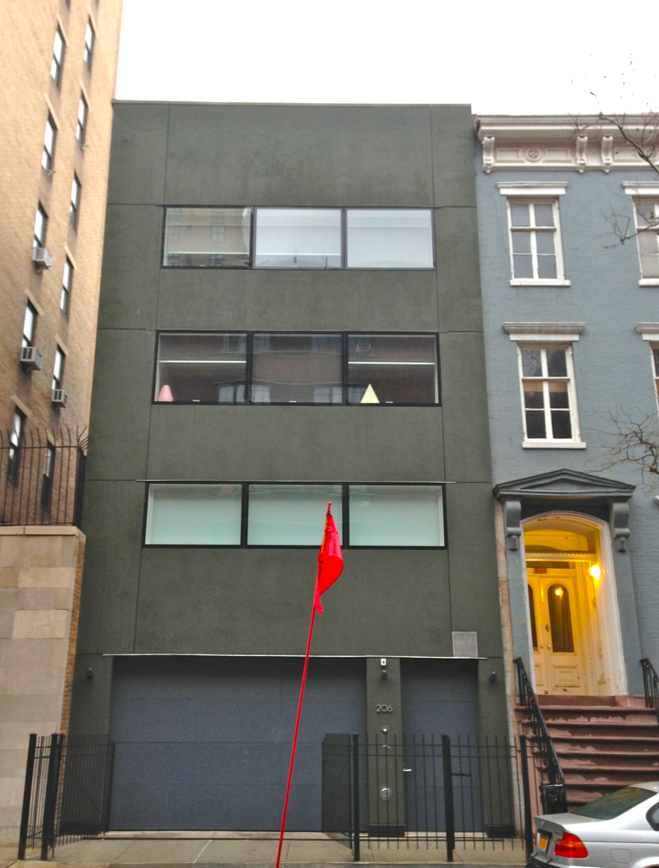 Is this the ugliest brownstone in chelsea ephemeral new for Nyc townhouse with garage
