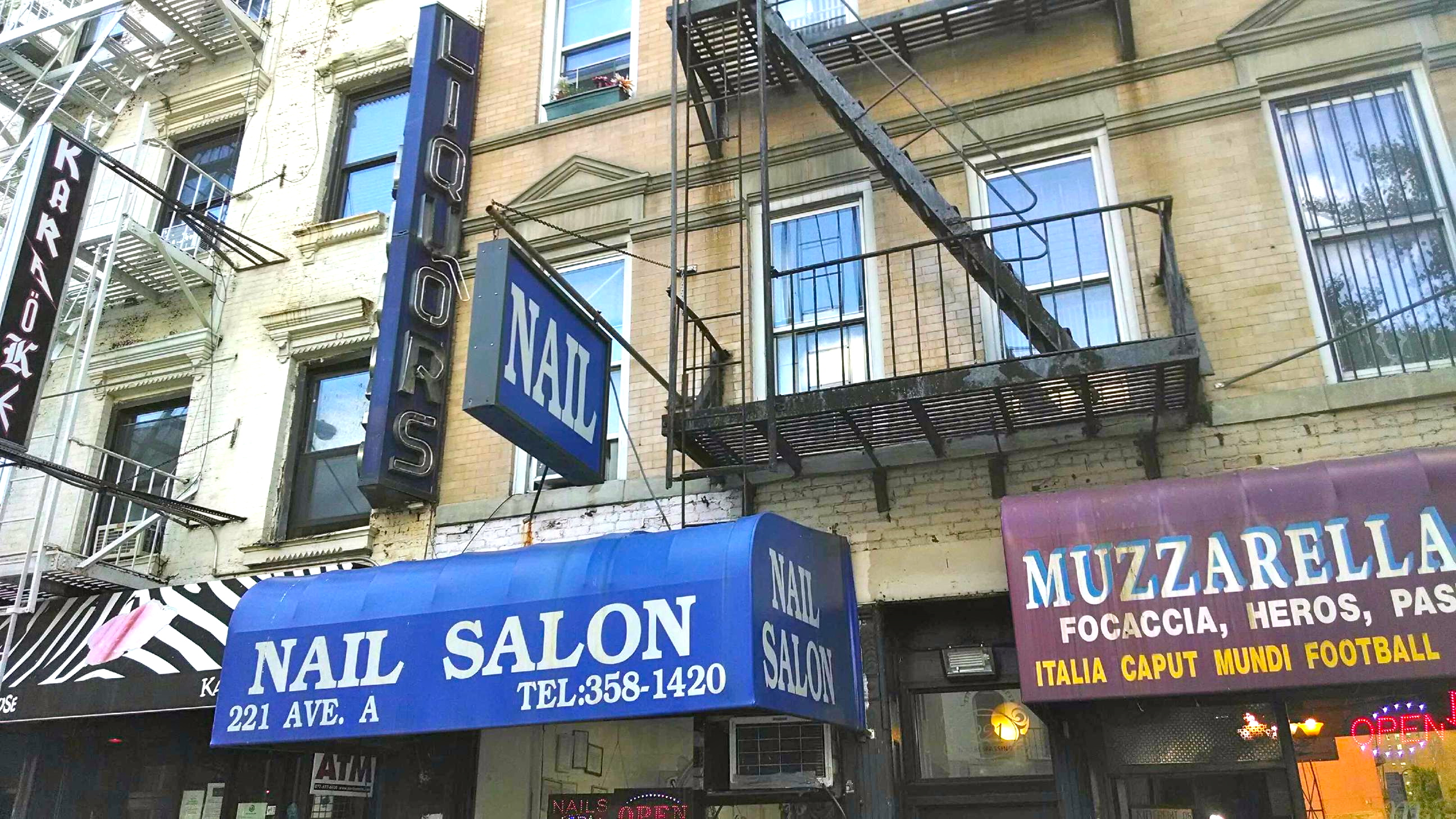 Ghost signs hanging over storefronts in manhattan for 14th avenue salon