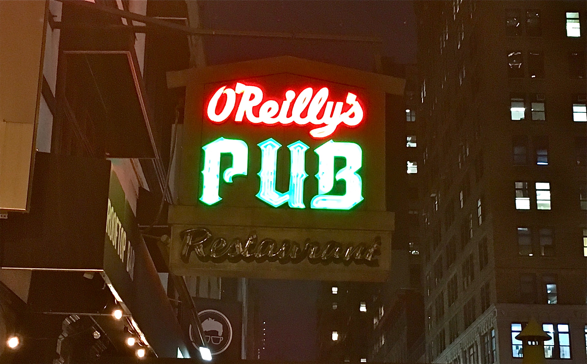 A Midtown bar\'s neon sign lights up New York | Ephemeral New York